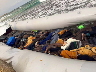 Tellforceblog: Photo: Rubber boat packed with bodies of African migrants washed ashore in Libya