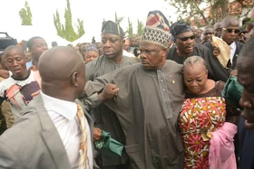 Photos: Governor Amosun rescues Governor Aregbesola's female aide from attack