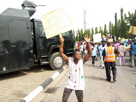 Photos/Video: Supporters of Ali Ndume barricade National Assembly gate, demand the reversal of his suspension