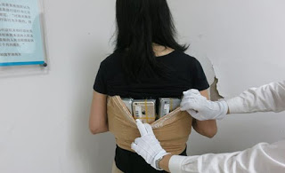 Smuggler arrested with 102 iPhones strapped to her body